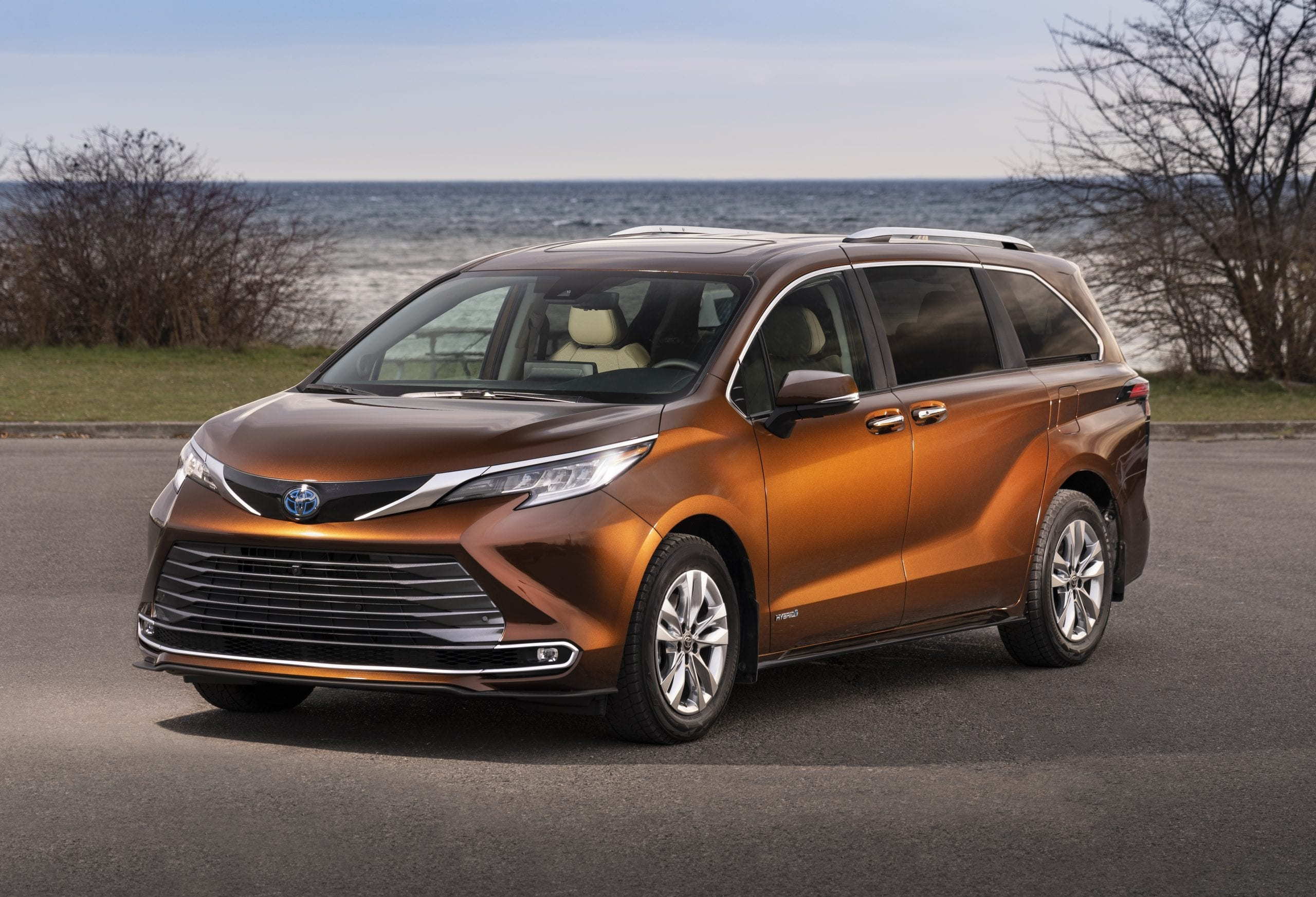 2021 toyota sienna orange side profile outdoor lake